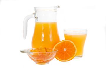 Orange juice in pitcher and orange jam.