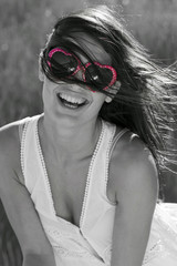 Foto op Canvas Rood, zwart, wit Portrait of cute young woman with sunglasses