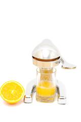 making the orange juice. old metal juicer