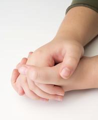 child hands on white