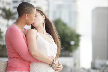 Young gay female couple kissing