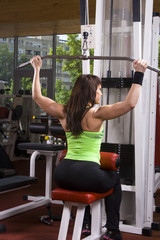 Muscular woman in the gym