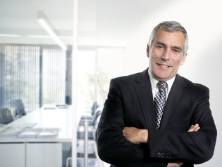 gray hair businessman interior white office