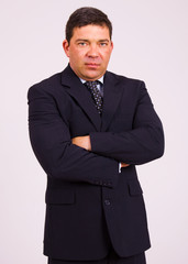 Portrait of a mature business man on a grey background