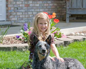 Cute Little Girl With Her Dog