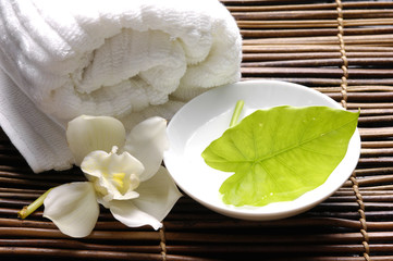 Spa with soft towel ,orchid ,green leave