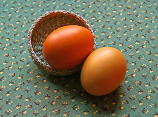 two eggs on green