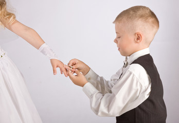 Young Boy and Young Girl exchange of rings