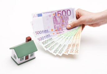 hand holding Euros; real estate loan concept