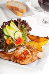 juicy pork steak with french fries