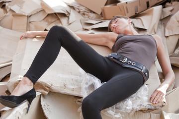 dead woman in paper cartons