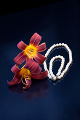 Pearl necklace by lilies.