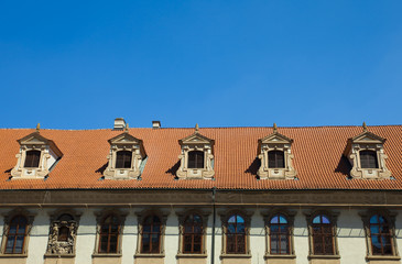 tiled roofs against the sky