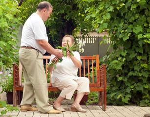couple seniors in house garden