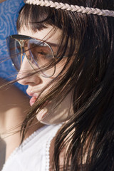 Profile of cute woman with sunglasses