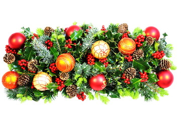 Christmas Decoration of Baubles, Holly and Natural Foliage