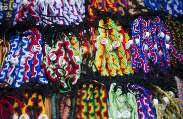 Colorful woven items at local market.