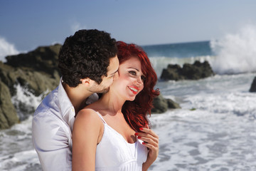 Young Couple at the beach showing affection