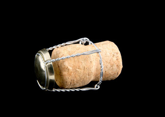 Champagne cork isolated on black background