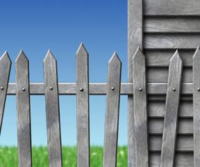 Schuppen mit Zaun und Wiese