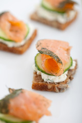 Appetizer of smoked salmon, cucumber and cream cheese