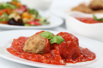 Roast meatballs with tomato sauce. Shallow DOF