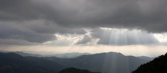 Mountains silhouette and sun rays