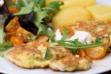 Zucchini omelet with eggs and blue cheese. Shallow DOF