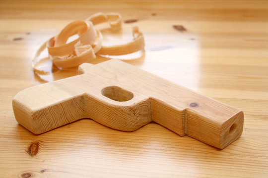 Wooden toy gun and woodchips