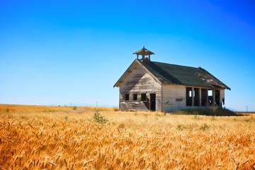 Old School House in wheat field