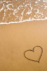 heart simbol on the sand
