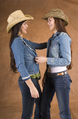 Twin cowgirls in jeans