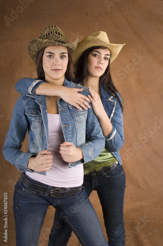 quottwin cowgirls in jeansquot stock photo and royaltyfree