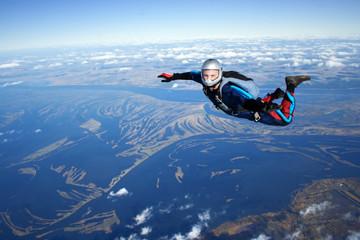 Foto op Aluminium Luchtsport Skydiver falls through the air
