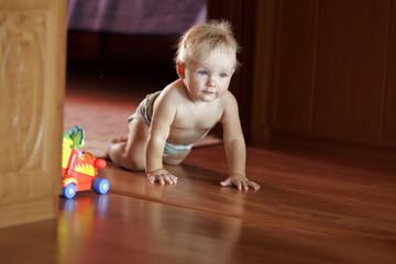 Baby creeps on floor