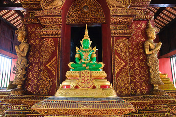 Emerald Budha between angels on side