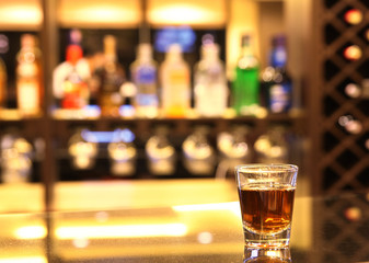 A shot of whiskey at bar
