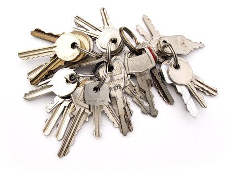 Five stes of keys on rings on white