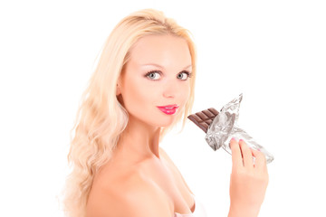 Beautiful young happy smiling woman eating chocolate. Isolated o