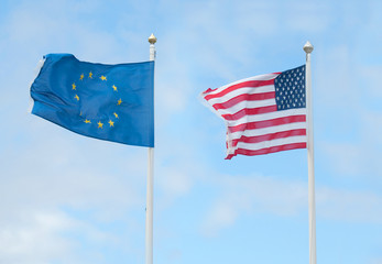 american and european flags in wind