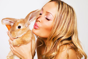 Portrait of a pretty girl with a rabbit