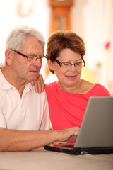 Closeup of senior couple doing online shopping