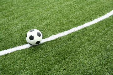 football on soccer field with curve line