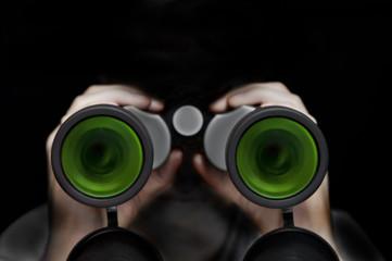 Man with binocular in the dark