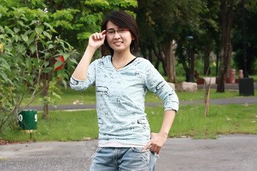 asian woman smiling in the park