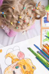 pencils and tails of hair