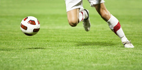 Soccer player running after the ball