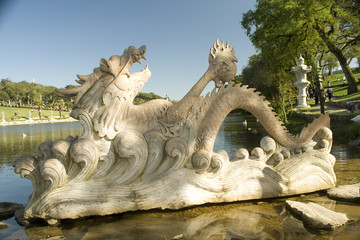 One big chinese dragon marble statue on the water