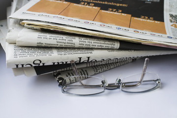 Glasses and newspapers.