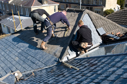 Roofers measuring
